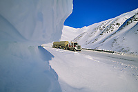 Semi tractor trailer travels down north side of Atigun Pass, James Dalton Highway, Brooks range, Alaska