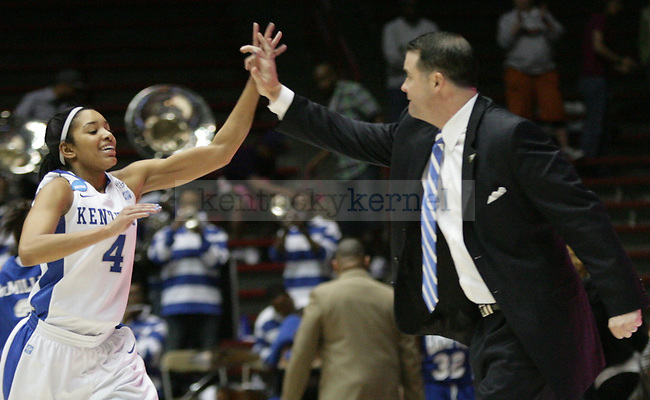 UK Hoops' junior guard Keyla Snowden and head coach Matthew Mitchell high-five after winning their first round NCAA game against Hampton in The Pit in Albuquerque, New Mexico, 3/19/11. Photo by Brandon Goodwin | Staff.