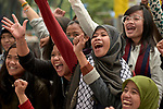 Indonesian domestic workers in Hong Kong cheer as they gather in a public park on Sunday, their only day off. Some 370,000 foreign domestic workers live in Hong Kong, about five percent of the population. Most are women from the Philippines and Indonesia.