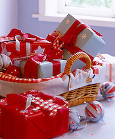 Paper shapes have been added to Christmas gifts wrapped in plain paper and ribbon adding a personal touch