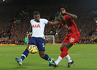 27th October 2019; Anfield, Liverpool, Merseyside, England; English Premier League Football, Liverpool versus Tottenham Hotspur; Sadio Mane of Liverpool cuts the ball back across the Tottenham six yard box under pressure from Serge Aurier of Tottenham Hotspur - Strictly Editorial Use Only. No use with unauthorized audio, video, data, fixture lists, club/league logos or 'live' services. Online in-match use limited to 120 images, no video emulation. No use in betting, games or single club/league/player publications