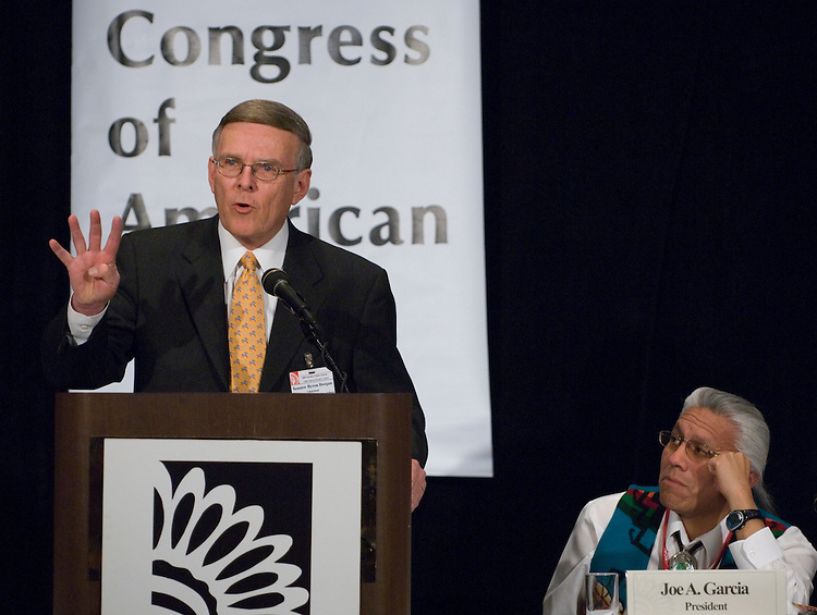 Senate Committee on Indian Affairs chairman Byron Dorgan, D-N.D., speaks as National Congress of American Indians president Joe Garcia listens at the NCAI  winter meeting in Washington on Monday, Feb. 26, 2007.