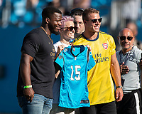 CHARLOTTE, NC - JULY 20: Megan Rapinoe of the US Women's National team poses with Jonathan Stewart and Christian MaCaffery prior to the soccer match between Arsenal and Fiorentina during a game between ACF Fiorentina and Arsenal at Bank of America Stadium on July 20, 2019 in Charlotte, North Carolina.