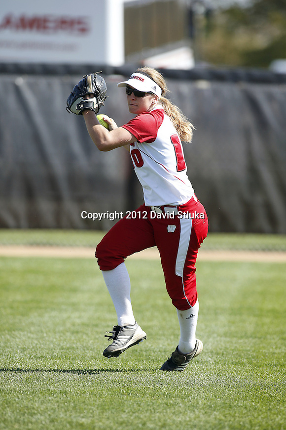 Wisconsin Badgers Maria Van Abel (10) throws the ball during warmups prior to an NCAA women's softball game against the Green Bay Phoenix Saturday, September 29, 2012 in Madison, Wis. (Photo by David Stluka)