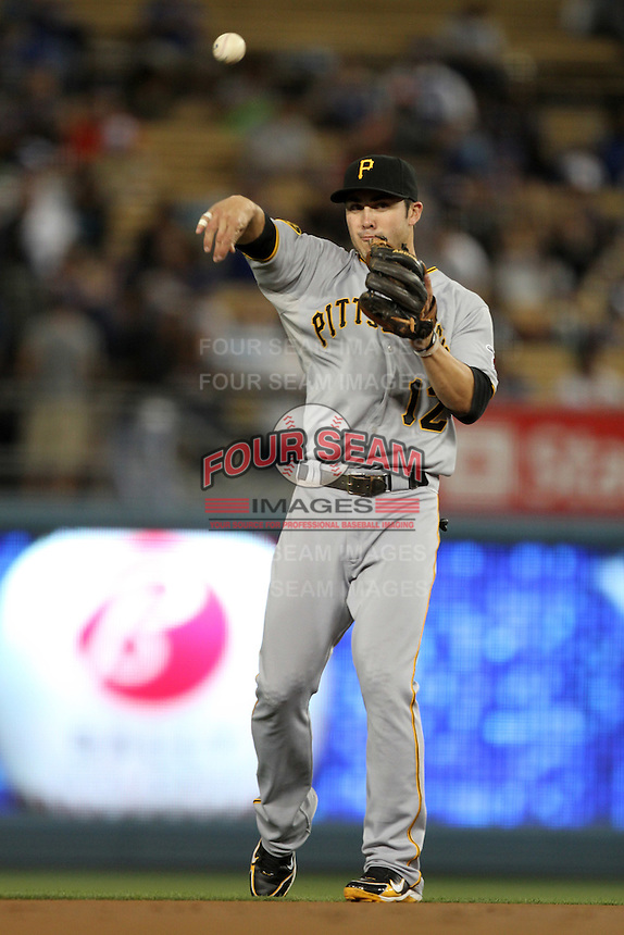 Pittsburgh Pirates shortstop Chase d'Arnaud #12 during a game against the Los Angeles Dodgers at Dodger Stadium on September 17, 2011 in Los Angeles,California. Los Angeles defeated Pittsburgh 6-1.(Larry Goren/Four Seam Images)