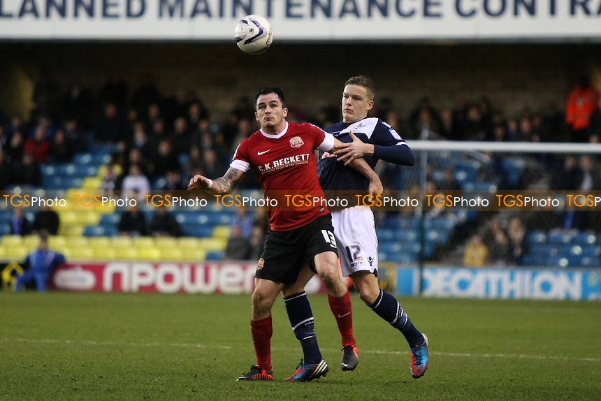 Chris Dagnall of Barnsley and Shane Lowry of Millwall - Millwall vs Barnsley - NPower Championship Football at the New Den, London - 22/12/12 - MANDATORY CREDIT: George Phillipou/TGSPHOTO - Self billing applies where appropriate - 0845 094 6026 - contact@tgsphoto.co.uk - NO UNPAID USE.