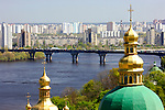 Travel stock photo of View on Paton bridge over the Dnieper river and golden cupola of a church from Kiev pechersk lavra Cave monastery in Kiev Ukraine Eastern Europe Horizontal orientation May 2007