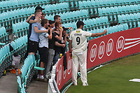 Kent bowler, Grant Stewart takes a selfie with some young supporters as the players leave the field for bad light during Surrey CCC vs Kent CCC, Specsavers County Championship Division 1 Cricket at the Kia Oval on 7th July 2019