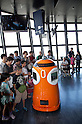 "August 01 2012, Tokyo, Japan - Visitors see and take pictures to the new robot guide ""Tawabo"" at vantage point of Tokyo Tower. Tokyo Tower implemented the new robot guide which name is ""Tawabo"", the first indoor robot guide in Japan. It can speak Japanese, English, Chinese and Korean, it weights 200kg and it is 160cm tall."