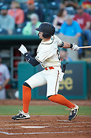Brett Kinneman (27) of the Greensboro Grasshoppers follows through on his swing against the Hagerstown Suns at First National Bank Field on April 6, 2019 in Greensboro, North Carolina. The Suns defeated the Grasshoppers 6-5. (Brian Westerholt/Four Seam Images)
