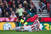 30th September, bet365 Stadium, Stoke-on-Trent, England; EPL Premier League football, Stoke City versus Southampton; Stoke City's Peter Crouch makes a sliding tackle on Southampton's Mario Lemina