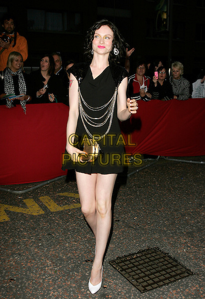 SOPHIE ELLIS BEXTOR.Arrivals - Greatest Britons 2007 Awards Show, .The London Studios, London, Engand, May 21st 2007. .full length black mini dress silver chains sequined shoulders gold bag purse white shoes hand arm.CAP/AH.©Adam Houghton/Capital Pictures.