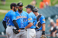 Akron RubberDucks starting pitcher Shawn Morimando (32) talks with pitching coach Tony Arnold (27) as first baseman Nellie Rodriguez (25) and catcher Eric Haase (13) listen in during the first game of a doubleheader against the Bowie Baysox on June 5, 2016 at Prince George's Stadium in Bowie, Maryland.  Bowie defeated Akron 6-0.  (Mike Janes/Four Seam Images)
