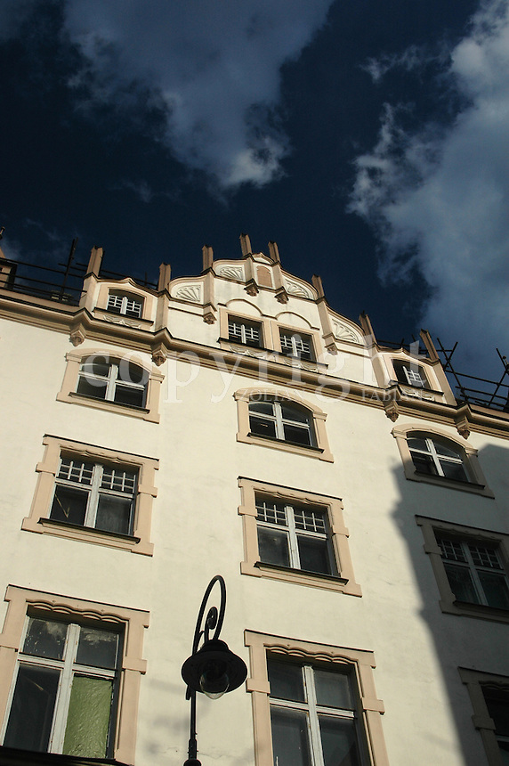 Facade of a classic house with dark blue sky in Karlovy Vary, Czech Republic, Europe