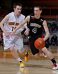 RAPID CITY, S.D. -- March 20, 2014 -- Ryan Olson #4 of Yankton drives on Ty Warkenthien #10 of Sioux Falls Roosevelt during their opening round game at the 2014 South Dakota State AA Boys Basketball Tournament at the Barnett Arena in Rapid City Thursday. (Photo by Dick Carlson/Inertia)