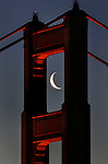 The Golden Gate Bridge south tower framed the morning crescent shaped moon perfectly as viewed from the Marin headlands of Sausalito, California.
