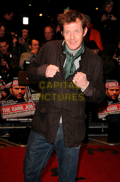 """JASON FLEMMING.World Premiere of """"The Bank Job"""" held at the Odeon West End cinema, Leicester Square, London, England, February 18th 2008..half length brown shirt green scarf tie fists funny.CAP/CAN.?Can Nguyen/Capital Pictures"""