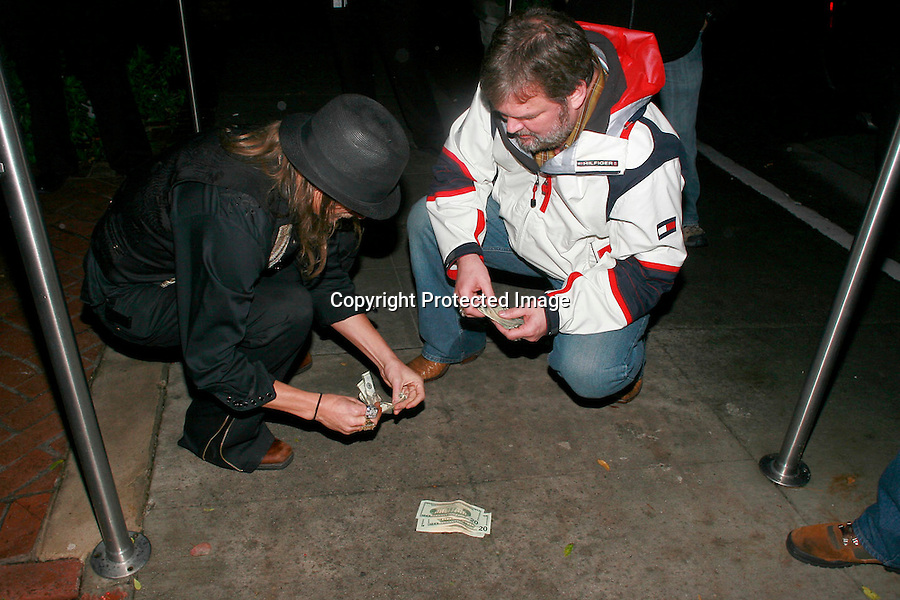 .1-6-09 Exclusive .Kid rock throwing dice gambling with the manager of ZZ Top JP Sheldrack. They were in the middle of the street after leaving Bar 1200 at the sunset marquis in west Hollywood ca. Billy Gibbons from ZZ Top was also with them & handed out 2 dollar bills to all the valets and photographers. ...www.AbilityFilms.com.805-427-3519.AbilityFilms@yahoo.com..