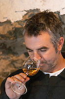 Christophe Bousquet Chateau Pech-Redon. La Clape. Languedoc. Owner winemaker. Tasting wine. France. Europe.