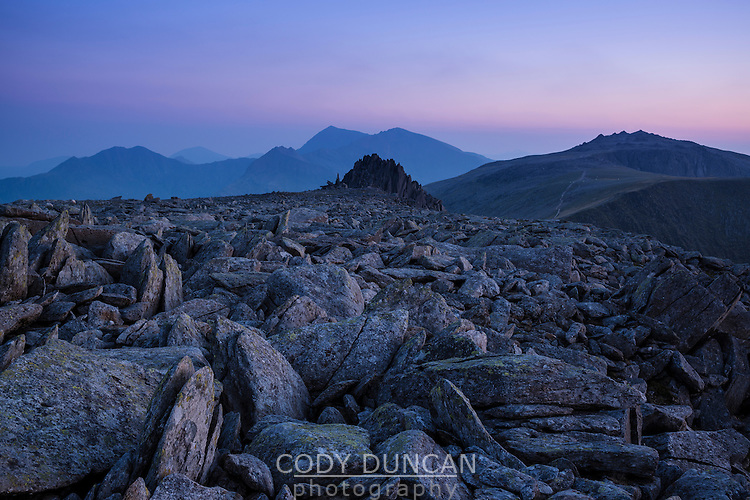 Castell y Gwynt - Castle of the wind with Snowdon in the background from summit of Glyder Fach, Snowdonia national park, Wales