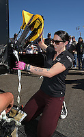 Feb. 14, 2013; Pomona, CA, USA; NHRA funny car driver Alexis DeJoria packing her parachutes during qualifying for the Winternationals at Auto Club Raceway at Pomona.. Mandatory Credit: Mark J. Rebilas-