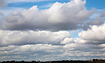 Banks of heavy cumulus clouds in a  line across the sky, Alderton, Suffolk, England