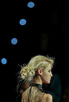 A model presents a creation by Modesto Lomba during the Pasarela Cibeles fashion show 2005, February 15, 2005 in Madrid. Photo by Victor Fraile / studioEAST