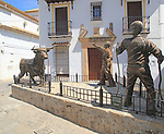 Sculpture of two men and bull, village of Grazalema, Cadiz province, Spain celebrating local farming traditions