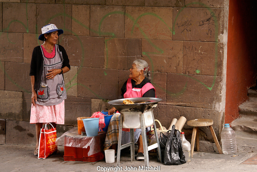 Two elderly woman chatting in San Miguel de Allende, Mexico