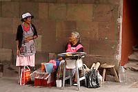 Two elderly woman chatting in San Miguel de Allende, Mexico
