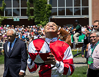 ELMONT, NY - JUNE 10: Mike Smith, jockey for Songbird #5 (not pictured), smiles as he watches the video board in the paddock before winning the Ogden Phipps Stakes on Belmont Stakes Day at Belmont Park on June 10, 2017 in Elmont, New York (Photo by Jesse Caris/Eclipse Sportswire/Getty Images)