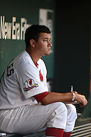 Springfield Cardinals pitcher Marco Gonzales (44) charts in the dugout during a game against the Frisco Rough Riders on June 1, 2014 at Hammons Field in Springfield, Missouri.  Springfield defeated Frisco 3-2.  (Mike Janes/Four Seam Images)