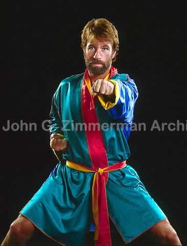 Chuck Norris, studio shoot, Los Angeles, 1983. Photo by John G. Zimmerman