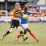 Nathan Oduwa flicks the ball over defender Colin Hamilton and runs away into the box