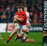 9th November 2019; Thomond Park, Limerick, Munster, Ireland; Guinness Pro 14 Rugby, Munster versus Ulster; Andrew Conway of Munster on his way to scoring a try despite the defensive tackle 22 -16 - Editorial Use
