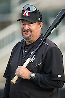 Kannapolis Intimidators pitching coach Brian Drahman (45) holds a fungo bat during fielding practice at Kannapolis Intimidators Stadium on April 6, 2016 in Kannapolis, North Carolina.  (Brian Westerholt/Four Seam Images)