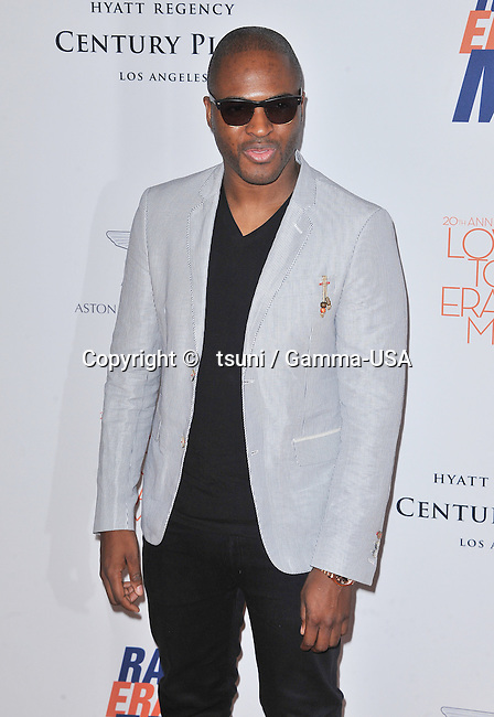 Taio Cruz arriving at The 20th Ann. Race To Erase MS 2013 at the Hyatt Hotel in Los Angeles.