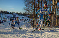 Competitors in the Junior Male 10K Classic make their way up gong hill during the 2018 U.S. National Cross Country Ski Championships at Kincaid Park in Anchorage.