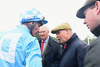 Trainer Clive Cox speaks to Jockey Adam Kirby after Winner of The S H Jones Wines Handicap with Maid of Spirit during Horse Racing at Salisbury Racecourse on 14th August 2019