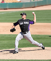 Rex Brothers of the Colorado Rockies pitches in a spring training game against the Los Angeles Dodgers at Camelback Ranch on March 24, 2011  in Glendale, Arizona. .Photo by:  Bill Mitchell/Four Seam Images.