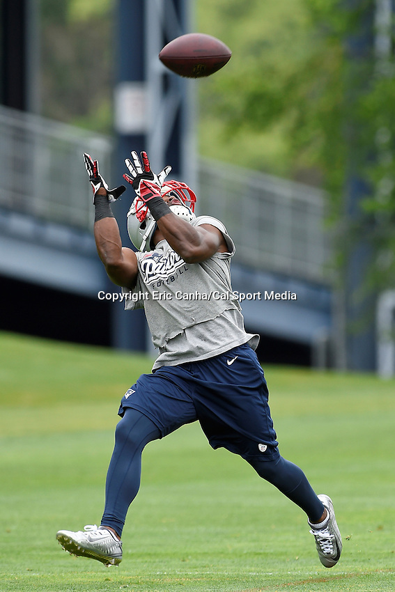 June 12, 2014 - Foxborough, Massachusetts, U.S. - New England Patriots running back  Roy Finch (29) makes a catch at the team's organized team activity at Gillette Stadium in Foxborough, Massachusetts. Eric Canha/CSM