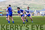 St Marys Captain Conor O'Shea works the ball out of the danger area as Desmonds Marc O'Connor plays catch up.