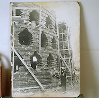 A contemporary black and white photograph showing the Melnikov House under construction