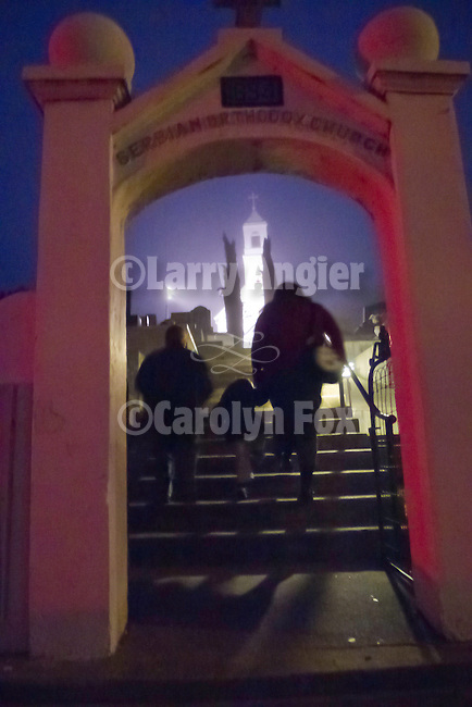 A family walks up the step to the church to celebrate Christmas Eve Vigil Service, St. Sava Serbian Orthodox Church, Jackson, Calif.