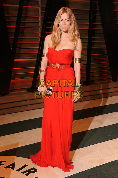 WEST HOLLYWOOD, CA - MARCH 2: Sienna Miller arrives at the 2014 Vanity Fair Oscar Party in West Hollywood, California on March 2, 2014.<br /> CAP/MPI<br /> &copy;MPI213/MediaPunch/Capital Pictures