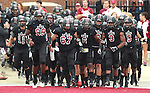 Lindenwood-Belleville players run on to the field as they are introduced during the first football game in Lindenwood-Belleville history.