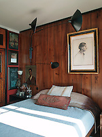 In the master bedroom has simple oak clad walls hung with a self-portrait by Turkish artist Feyhaman Duran and a Serge Mouille lamp. The portrait above the bed is of Hali Pasha, an Ottoman period painter