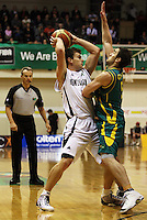 Boomers guard Adam Gibson tries to block Kirk Penney's pass during the International basketball match between the NZ Tall Blacks and Australian Boomers at TSB Bank Arena, Wellington, New Zealand on 25 August 2009. Photo: Dave Lintott / lintottphoto.co.nz