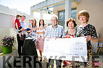 Front l-r  Ted Moynihan, Mary Shanahan and Mary Costello who presented a cheque to the Kerry Hospice Foundation for €12,108 from the Costello family in memory of Michael Costello. The money was raised on the 25th of June  by climbing Mount Brandon. Pictured l-r  Alex Costello, Sean Costello, Dillon Costello, Antoinette Costello, Jane Clifford and Nicola Costello.