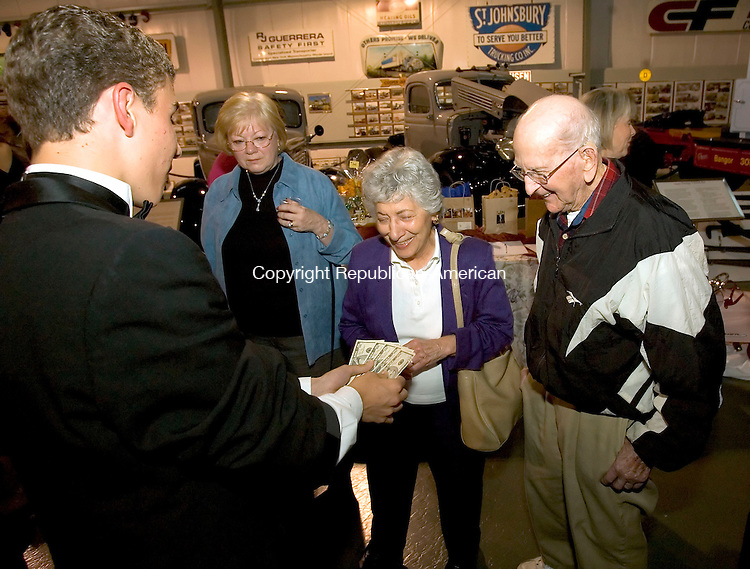MIDDLEBURY, CT-07 OCTOBER 2006-100706JS06-Magician Jonathan Jacques of Glastonbury, left, entertains Ginger and Floyd Quinn of Middlebury during the kick-off of the Middlebury Bicentennial celebration Saturday at the Golden Age of Trucking Museum in Middlebury. <br />  -Jim Shannon Republican-American